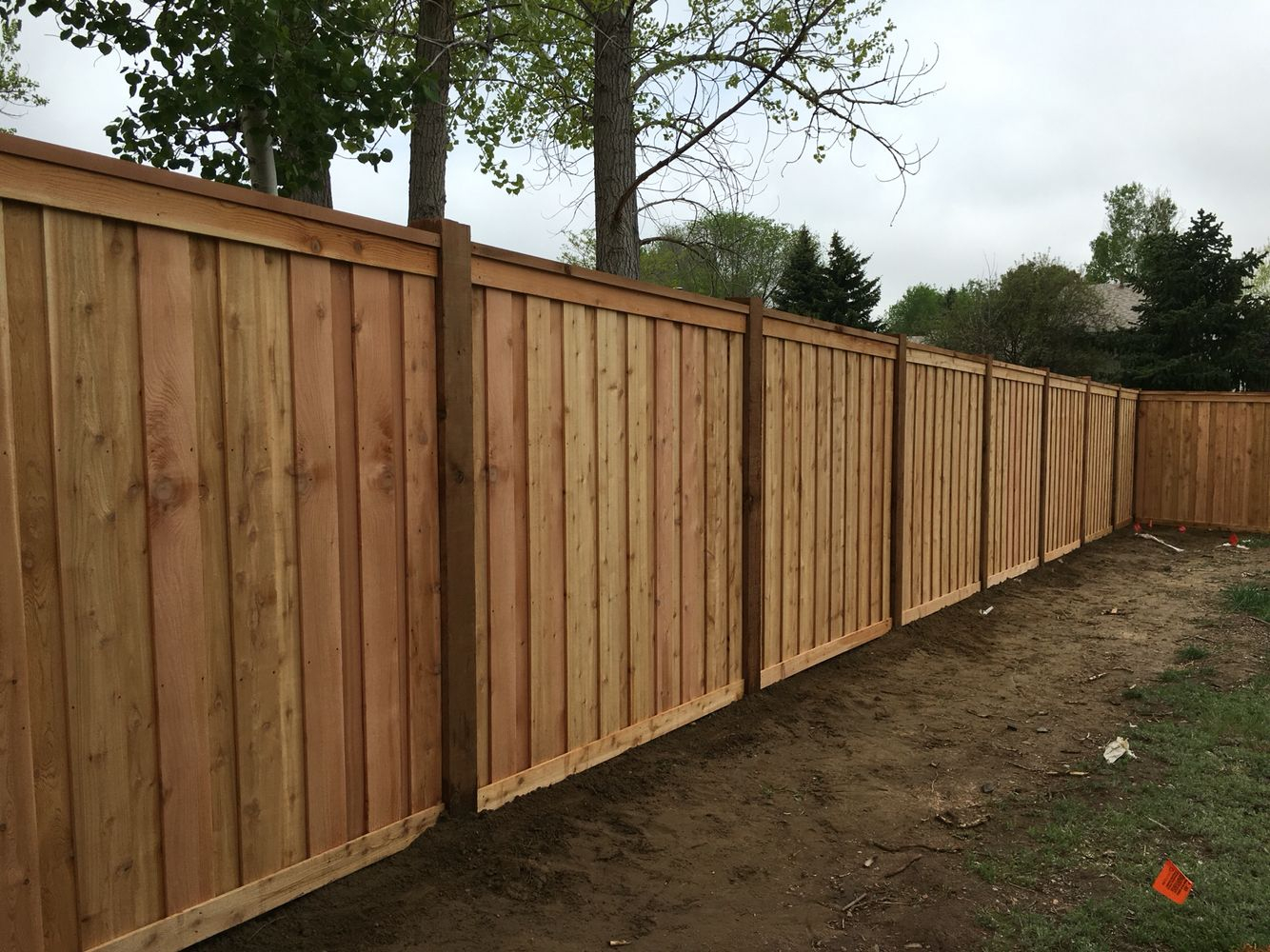 7 Tall Cedar Privacy Fence With 6x6 Posts 2x6 Top Cap 6 in proportions 1334 X 1000
