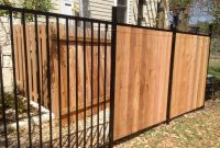 Custom Wrought Iron Fence Transitioning Into Privacy Cedar Fence with dimensions 3264 X 2448
