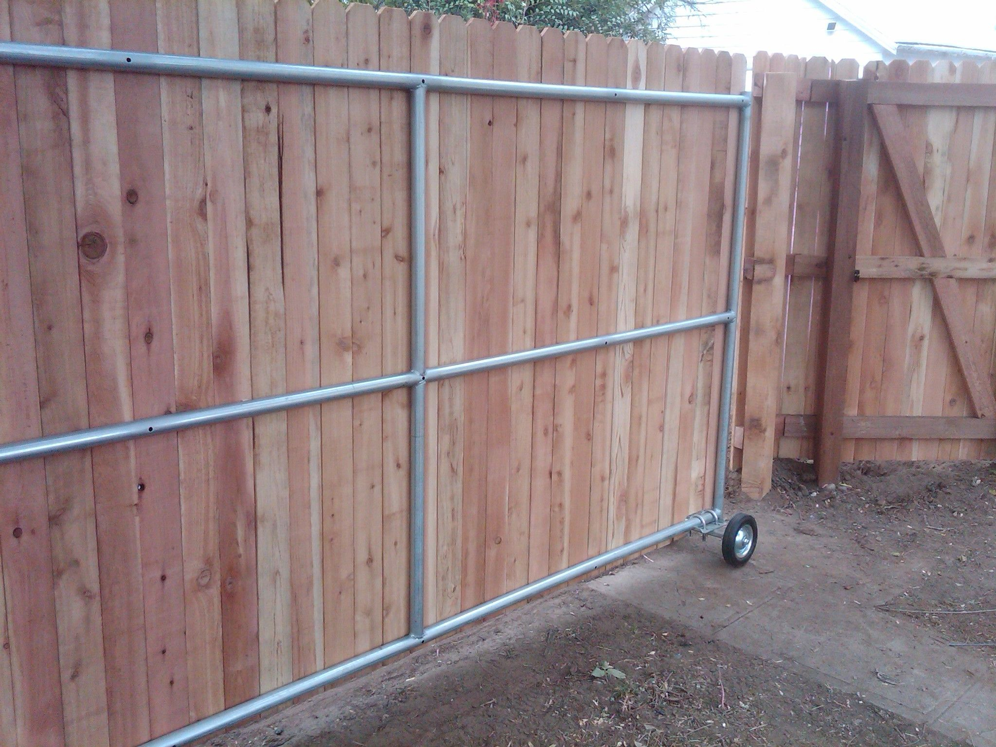 Wood Fence Ideas With A Gate Steel Framed Roll Gate With Wood in measurements 2048 X 1536