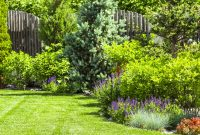 A Flower Garden In The Backyard In The Summer with measurements 1300 X 866